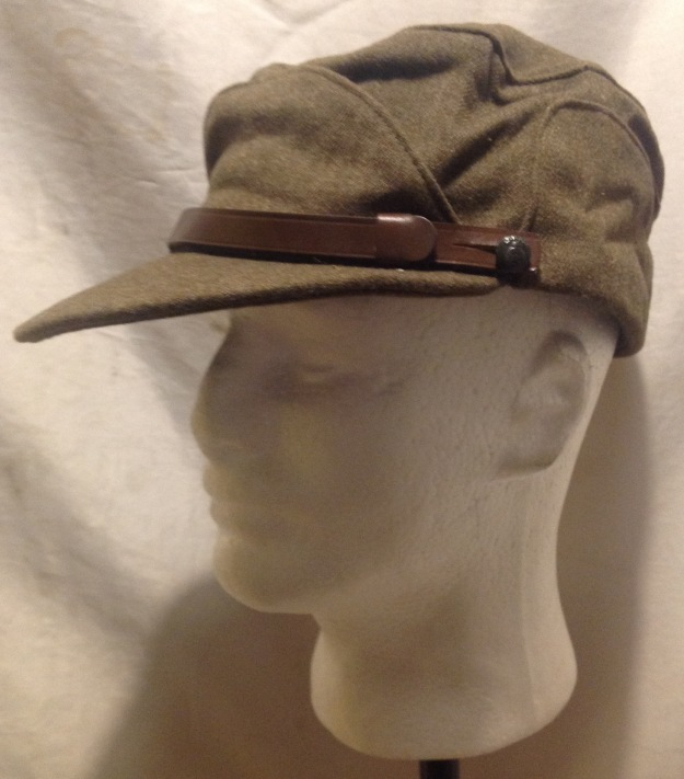 cd9864af7c3 This cap has a broad peak to keep the sun off and a brown leather chin  strap  image