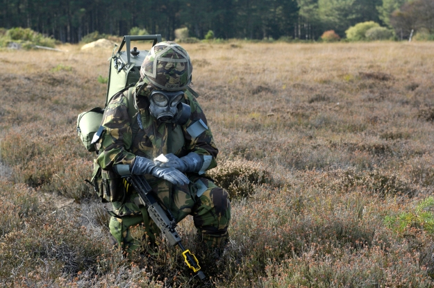 Soldier Carries Out Personal Decontamination Drills