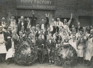 Poppy-Factory-employees-with-HRH-The-Prince-of-Wales