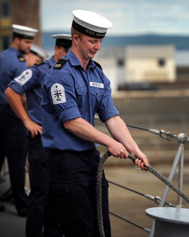 Sailor Holding Berthing Line on HMS Ednburgh